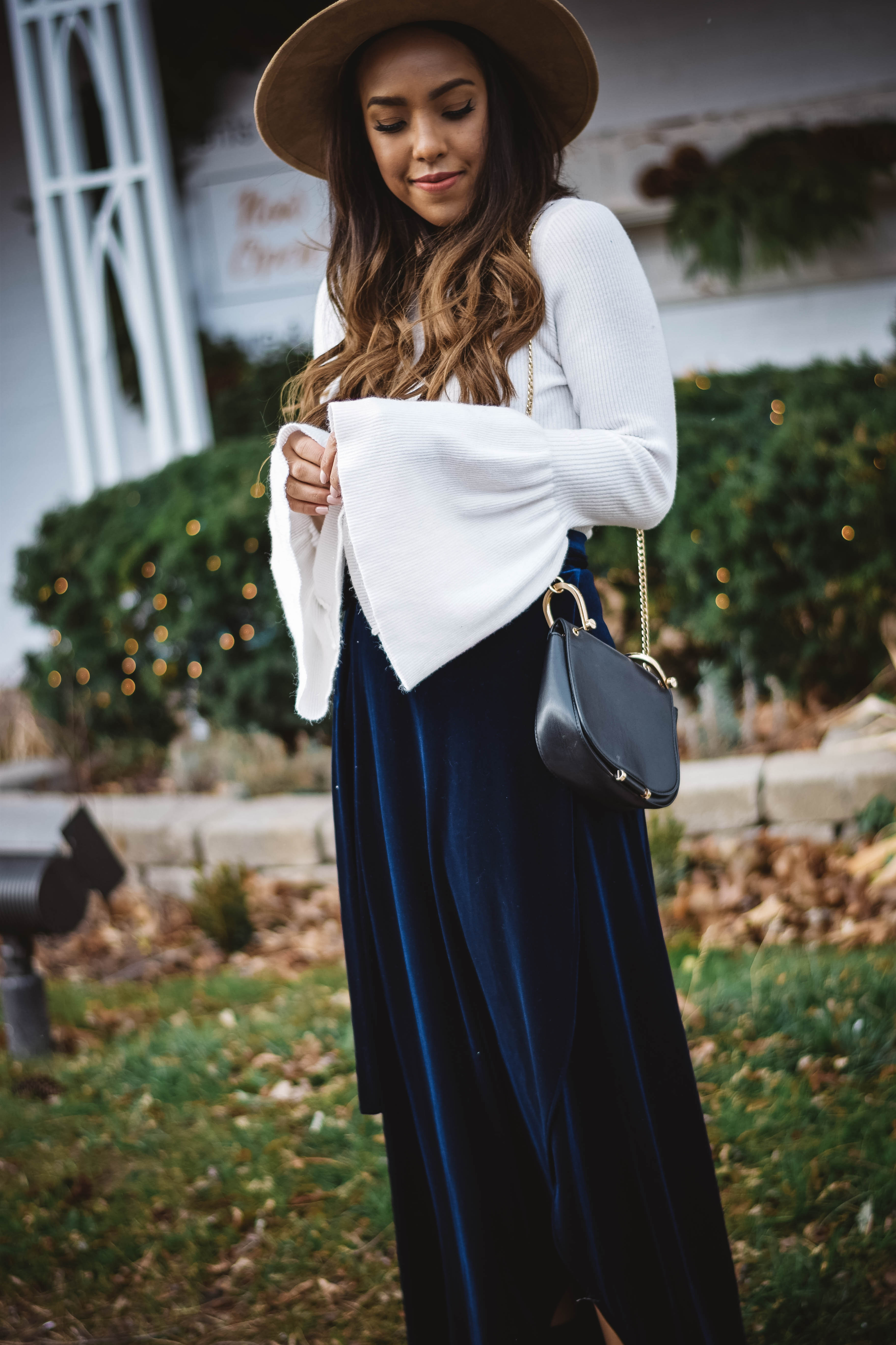 Fashion Blogger Lauren Sheriff of Basic Babe in Velvet skirt from Sans Souci Store, Forever 21 Bell Sleeve Top and Aldo Sock Boots